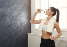 Beautiful young sport woman with towel and water royalty free stock image