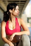 Beautiful young sports woman relaxing with earphones Royalty Free Stock Photography