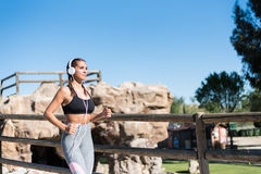 Beautiful young sports Woman running jogging in a park outdoors Stock Image