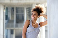 Beautiful young sports woman smiling with earphones Royalty Free Stock Photo