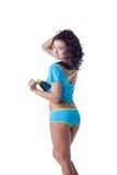 Beautiful young sportswoman posing back to camera royalty free stock photography
