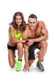 Beautiful young sporty couple posing and showing muscle Stock Photos