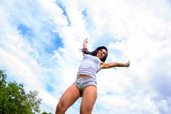 Beautiful young sporty girl in a park stock photo