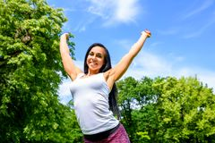 Beautiful young sporty girl in a park Royalty Free Stock Photography