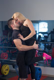 Beautiful young sporty sexy couple in gym Stock Photography