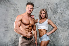 Beautiful young sporty sexy couple men and a woman posing Stock Photos