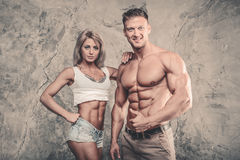 Beautiful young sporty sexy couple men and a woman posing Stock Images