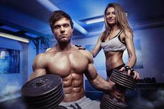 Beautiful young sporty sexy couple workout in gym Royalty Free Stock Images