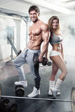 Beautiful young sporty sexy couple workout in gym Royalty Free Stock Image
