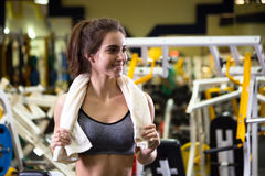 Beautiful young sporty woman. Fitness girl training in sport club with exercise equipments. Stock Photo