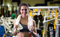 Beautiful young sporty woman. Fitness girl training in sport club with exercise equipments. royalty free stock photography