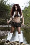 Beautiful young strong hunter warrior woman Stock Photos