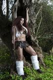 Beautiful young strong hunter warrior woman Stock Photography