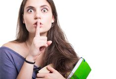 Beautiful young student doing silence gesture Stock Image