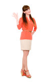 Beautiful young student in dress waving her hand. Royalty Free Stock Image