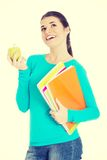 Beautiful young student with files and apple. Royalty Free Stock Photos