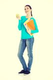 Beautiful young student with files and apple. Stock Images