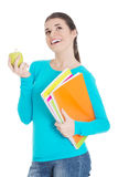 Beautiful young student with files and apple. Stock Photos