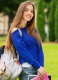 Beautiful young student girl in a park Stock Image