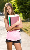 Beautiful young student girl showing thumbs up. Stock Images