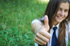 Beautiful young student girl is showining  okay Stock Image
