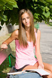 Beautiful young student girl studying outdoors. Royalty Free Stock Images