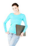 Beautiful young student with laptop. Stock Photo