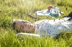 Beautiful young student lying in the park Stock Images