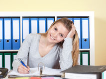 Beautiful young student at office Royalty Free Stock Photography