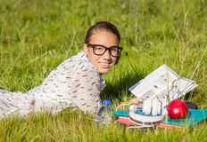 Beautiful young student reading a book in the park Stock Image