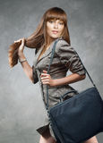 Beautiful young student with shoulder bag Royalty Free Stock Photography