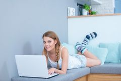 Beautiful young student studying at home Stock Photos