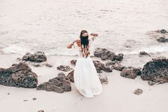 Beautiful young stylish boho woman on the beach at sunset Royalty Free Stock Images
