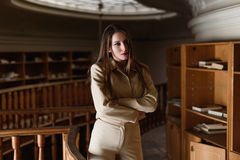 Beautiful young stylish lady posing in the vintage library Stock Photos