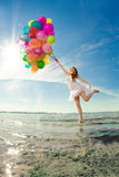 Beautiful young stylish woman with multi-colored rainbow balloon Royalty Free Stock Photography