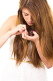 Beautiful young supersticious woman eating grapes Stock Image