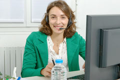 Beautiful young support phone operator with headset Stock Images
