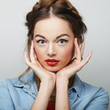 Beautiful young surprised blond woman Stock Photography