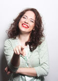 Beautiful young surprised curly woman. Stock Images