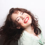 Beautiful young surprised curly woman. Stock Photos
