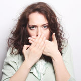 Beautiful young surprised curly woman. Royalty Free Stock Photography