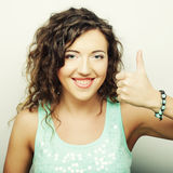 Beautiful young surprised curly woman. Stock Photo