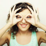 Beautiful young surprised curly woman. Stock Image