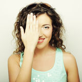 Beautiful young surprised curly woman. Royalty Free Stock Image