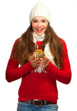 Beautiful young surprised woman holding a gift Royalty Free Stock Images