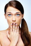 Beautiful young surprised woman Stock Images
