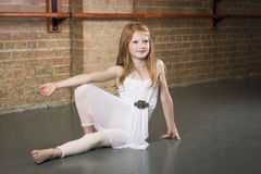 Beautiful young and talented dancer posing at a dance studio. Full length photo of a cute ballerina with copy space Stock Photography