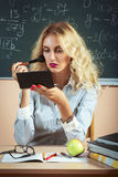 Beautiful young teacher making-up Royalty Free Stock Photo