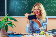 Beautiful young teacher making-up Stock Photo