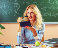 Beautiful young teacher making-up Royalty Free Stock Images